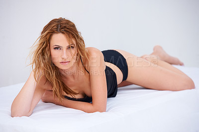 Buy stock photo Portrait of a beautiful woman in her lingerie posing seductively
