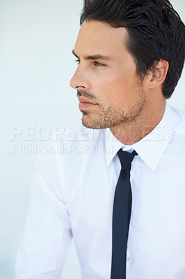 Buy stock photo A handsome young businessman looking away