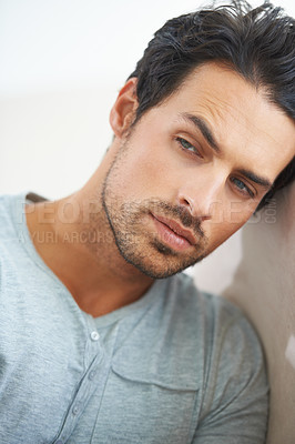 Buy stock photo A gorgeous young man resting on a sofa at home