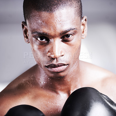 Buy stock photo An african american boxer with a look of determination in his eyes