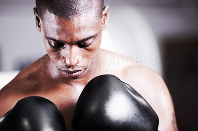 Buy stock photo A young boxer taking some time to visualize before a fight