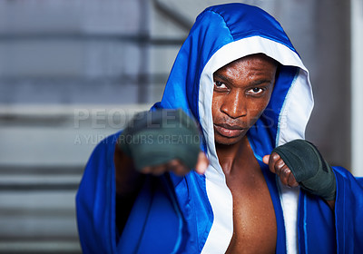 Buy stock photo An african american boxer with his fists up and a determined look in his eye