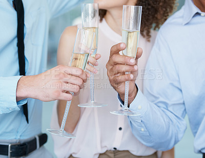 Buy stock photo Cropped image of a group of businesspeople toasting champagne to their success