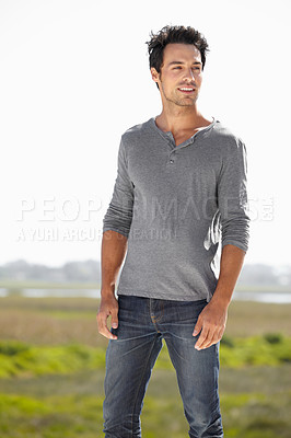Buy stock photo A handsome young man standing outside