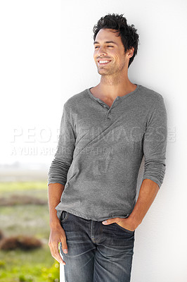 Buy stock photo A handsome young standing outside with his hand in his pocket