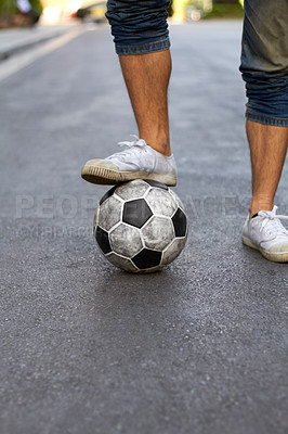 Buy stock photo Cropped image of a foot resting on a soccer ball