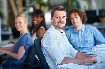 Buy stock photo Cropped shot of four businesspeople sitting in the office
