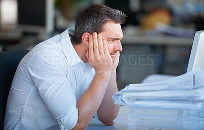 Buy stock photo Cropped shot of a businessman sitting with his head in his hands and looking frustrated=