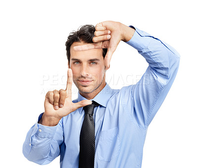 Buy stock photo A handsome young businessman making a frame with his fingers