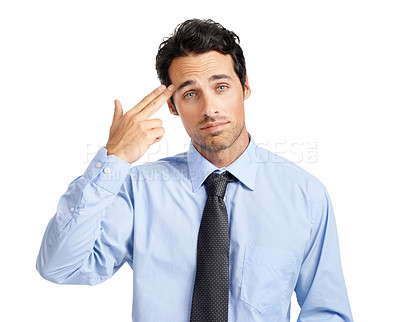 Buy stock photo A miserable young businessman pulling a gun gesture at his head
