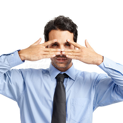 Buy stock photo A young businessman covering his face and peering through his fingers