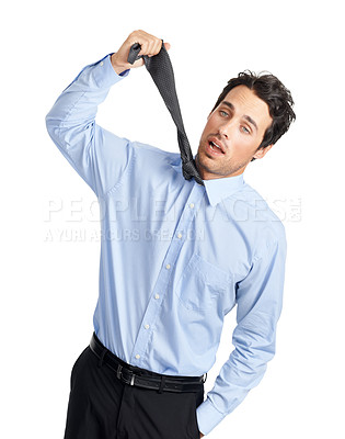 Buy stock photo Shot of a young businessman being choked by his own necktie