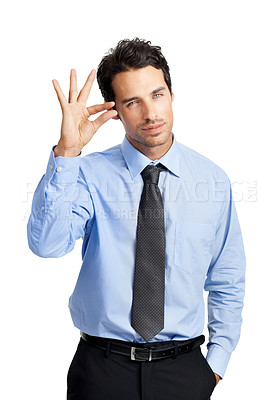 Buy stock photo A young businessman indicating a small size with his fingers