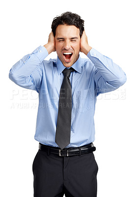 Buy stock photo A frustrated young businessman yelling while covering his ears
