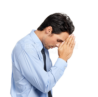 Buy stock photo A young businessman saying a desperate prayer