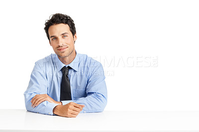 Buy stock photo Studio shot of a handsome businessman posing against a white background