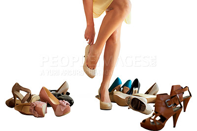Buy stock photo Cropped image of a woman trying on a pair of shoes isolated on white