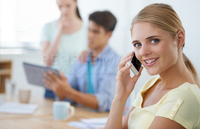 Buy stock photo Cropped shot of an attractive young businesswoman talking on her cellphone