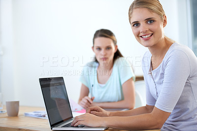 Buy stock photo Two young colleagues working in the office