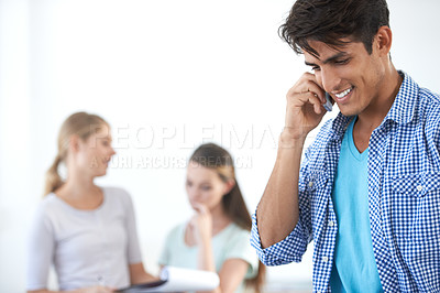 Buy stock photo Cropped shot of a handsome young businessman talking on his cellphone