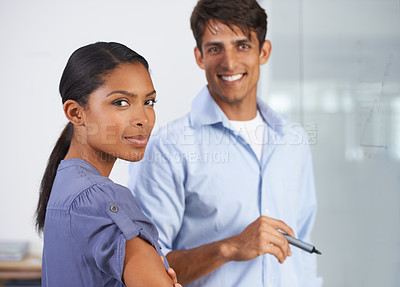 Buy stock photo Cropped shot of two young colleagues at