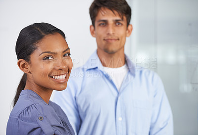 Buy stock photo Portrait of two young colleagues in the office