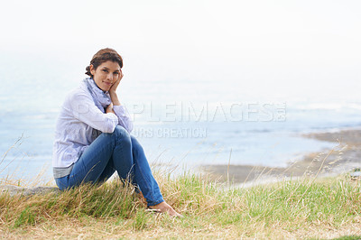 Buy stock photo Portrait of a mature woman taking a break from her walk to take in the scenery