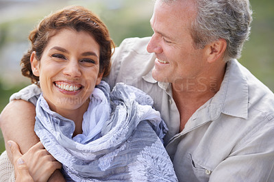 Buy stock photo Shot of a mature couple having fun while enjoying a day out in nature