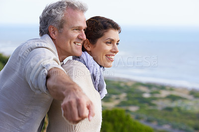 Buy stock photo A happy mature couple looking at an amazing view