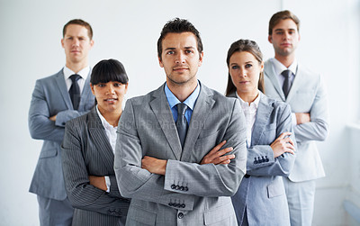 Buy stock photo Portrait of a confident business manager crossing his arms and standing with his team