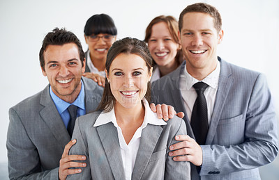 Buy stock photo A group of businesspeople standing proudly with their leader