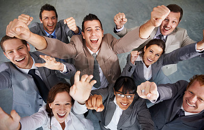 Buy stock photo Top view of a group of young business executives celebrating together