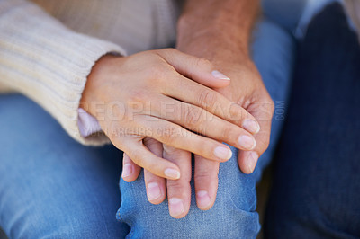 Buy stock photo Cropped image of a woman placing her hand affectionately on top of her lover's