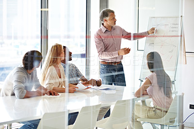 Buy stock photo Shot of a group of business colleagues in a boardroom meeting