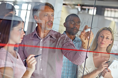 Buy stock photo A group of business associates brainstorming together