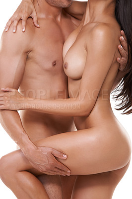 Buy stock photo Shot of a couple making love over a white background