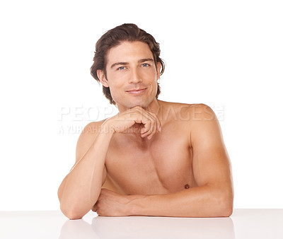 Buy stock photo Studio shot of a handsome man posing shirtless against a white background