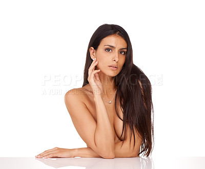 Buy stock photo Studio shot of a beautiful topless woman posing against a white background
