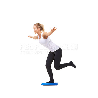 Buy stock photo Full length studio shot of a young woman doing balancing exercises isolated on white