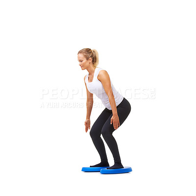 Buy stock photo Studio shot of a young woman doing squatting exercises isolated on white