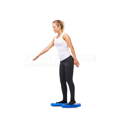 Buy stock photo Studio shot of an attractive young woman doing exercises isolated on white