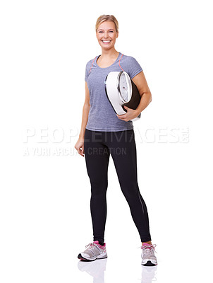 Buy stock photo Studio portrait of a sporty young woman holding a scale and  smiling at the camera isolated on white
