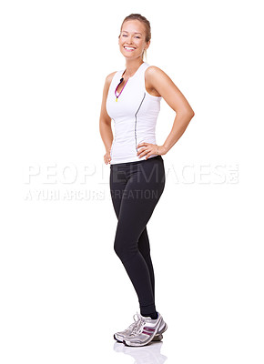 Buy stock photo Full length studio portrait of a sporty young woman smiling at the camera isolated on white