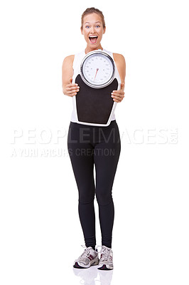 Buy stock photo Studio portrait of a sporty young woman showing a scale to the camera isolated on white