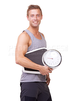 Buy stock photo Studio portrait of a handsome young man holding a scale and smiling at the camera isolated on white