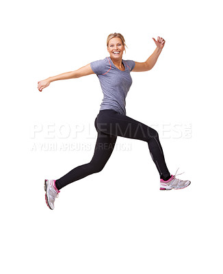 Buy stock photo Shot of an attractive young woman leaping through the air across the frame isolated on white