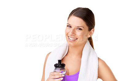 Buy stock photo Portrait of a sporty young woman with a towel draped over her shoulders and holding a water bottle isolated on white