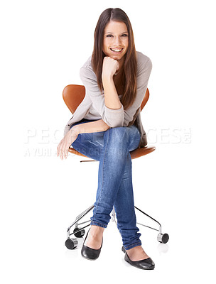 Buy stock photo Studio shot of a beautiful young woman sitting on a chair against a white background