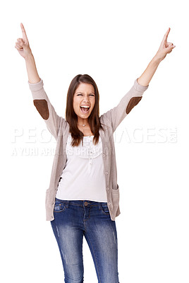 Buy stock photo Studio shot of a young woman pointing up and cheering against a white background