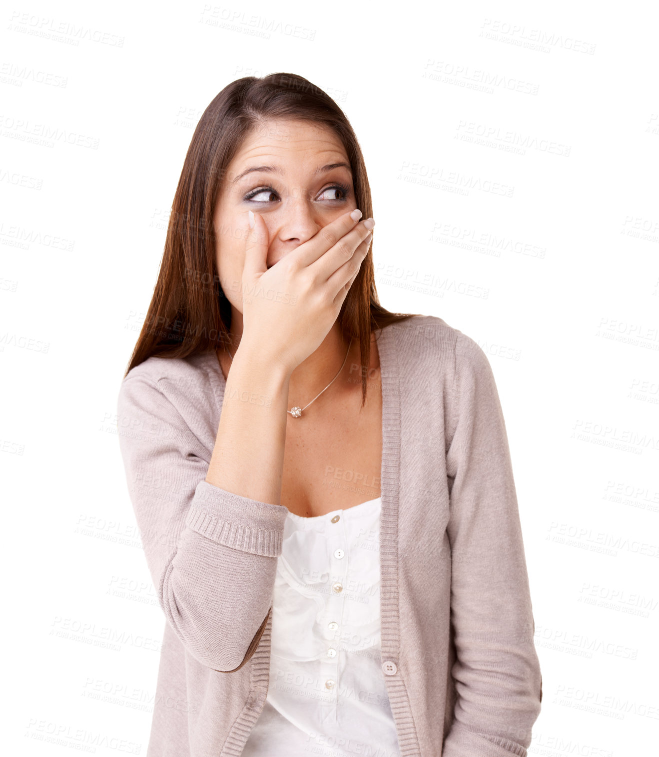Buy stock photo Surprised young woman covering her mouth against a white background